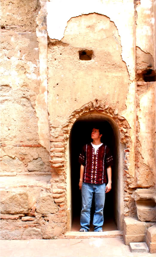 The author stands in an archway in the ruins of a Spanish mission monastery in Antigua, Guatemala.