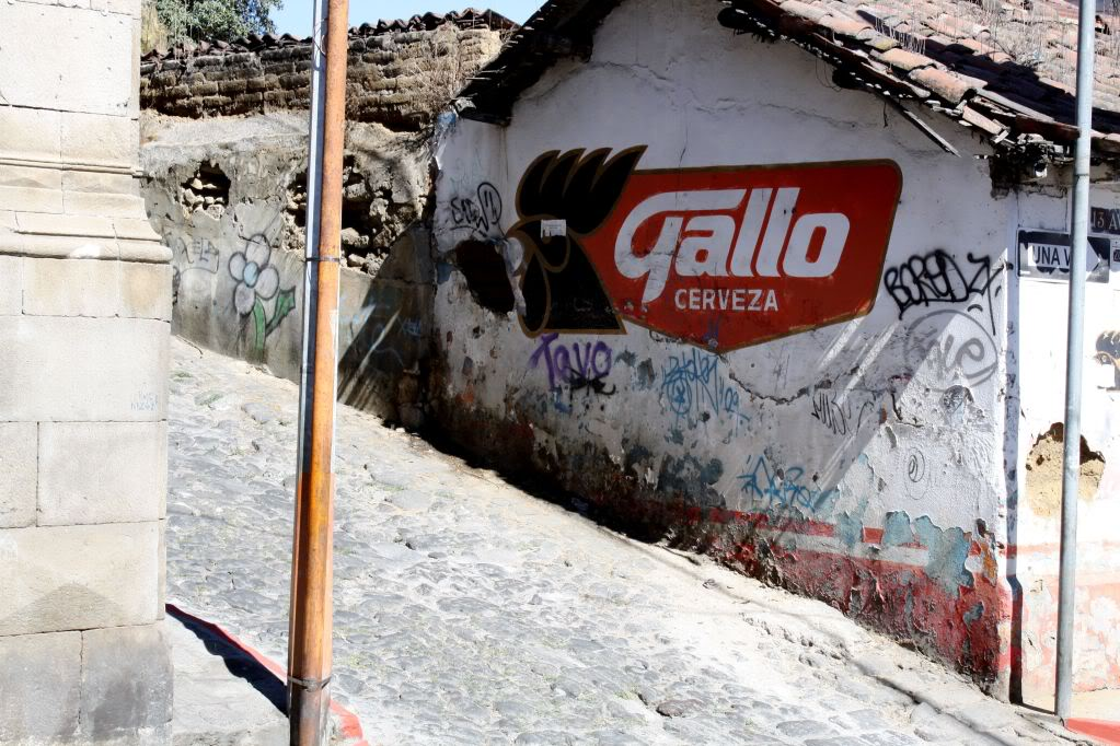 Advertisement for Gallo Beer on the side of a building in Xela, Guatemala.